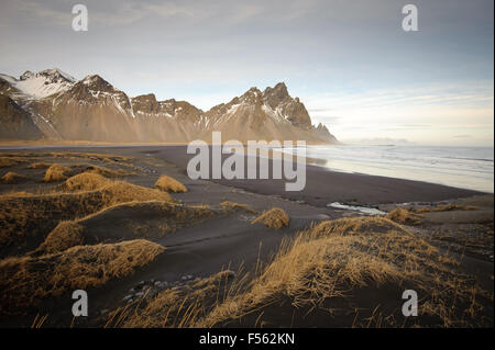 The Vestrahorn mountain in south east Iceland, viewed from the black volcanic sand beach on the Stokksnes peninsular, - Stock Photo