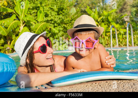 Happy mother and son in the swimming pool - Stock Photo