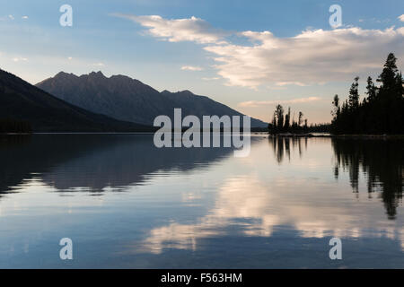 Evening clouds reflected over Leigh Lake, Grand Teton National Park, Wyoming - Stock Photo