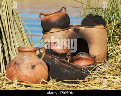 Traditional mad pans used on Uros islands, Peru, Bolivia. - Stock Photo
