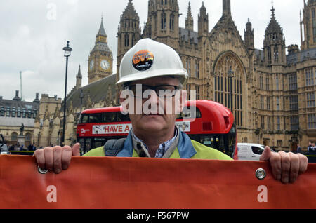London, UK, 28 October 2015, Steelworkers hold a protest in London opposite the Houses of Parliament calling for - Stock Photo