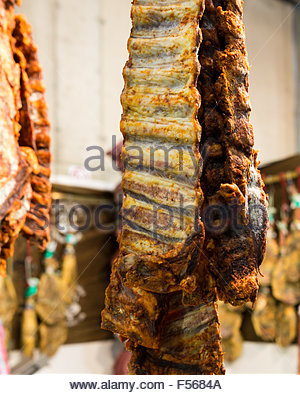 Pata Negra Spanish Ham hanging at an exhibtion in Aracena, Andalusia Spain - Stock Photo
