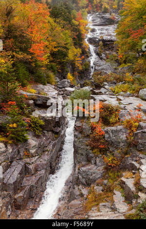 Silver Cascade falls in autumn, a waterfall in Crawford Notch state park, White Mountains National Forest, New Hampshire - Stock Photo