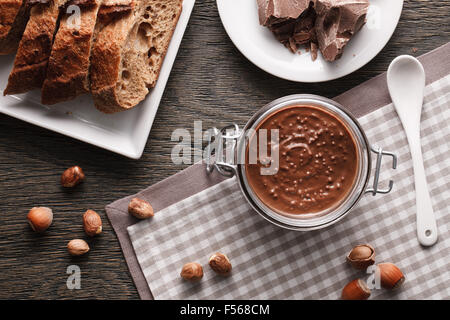 Hazelnut spread with nuts pieces - Stock Photo