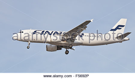 Finnair Airbus a320 OH-LXF coming into land at London Heathrow Airport LHR - Stock Photo