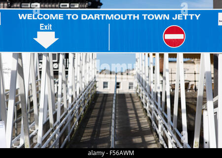 Exit and entry signs above the empty jetty leading off the River Dart into the Devon riverside town welcoming people - Stock Photo