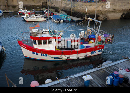 The fishing boat Stroma returning to Lossiemouth Harbour in Morayshire, Scotland, UK. - Stock Photo