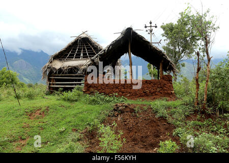 A shed house for agricultural purpose made with mud and palm leafs - Stock Photo