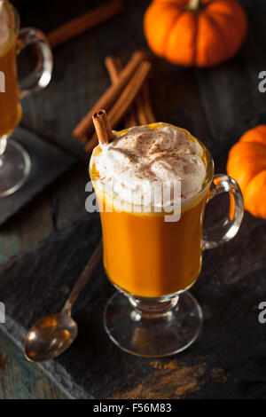 Homemade Boozy Pumpkin Cocktail with Whipped Cream - Stock Photo