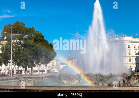 VIENNA, AUSTRIA - SEPTEMBER 29, 2015: rainbow at Hochstrahlbrunnen fountain on Schwarzenbergplatz, Vienna, Austria. - Stock Photo