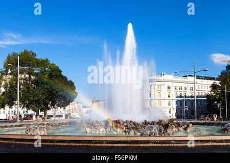 VIENNA, AUSTRIA - SEPTEMBER 29, 2015: rainbow at Hochstrahlbrunnen fountain on Schwarzenbergplatz in sunny day. - Stock Photo