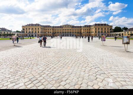 VIENNA, AUSTRIA - SEPTEMBER 29, 2015: people go to Schloss Schonbrunn palace from main entrance in garden. Schonbrunn - Stock Photo