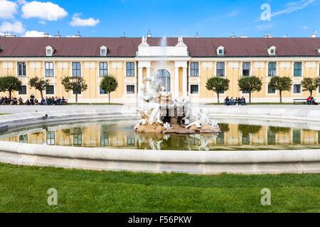 VIENNA, AUSTRIA - SEPTEMBER 29, 2015: tourists on benches near fountain in Schloss Schonbrunn palace garden. Schonbrunn - Stock Photo
