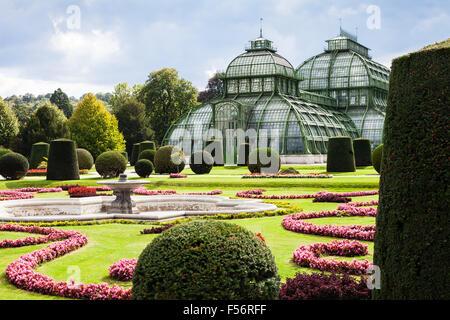 travel to Vienna city - Palmenhaus pavilion, large greenhouse in garden of Schloss Schonbrunn palace, Vienna, Austria - Stock Photo
