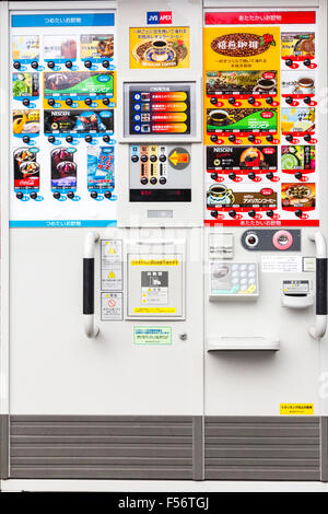 Front of Japanese coffee vending machine, showing display of different coffees and controls for adjustments to the - Stock Photo