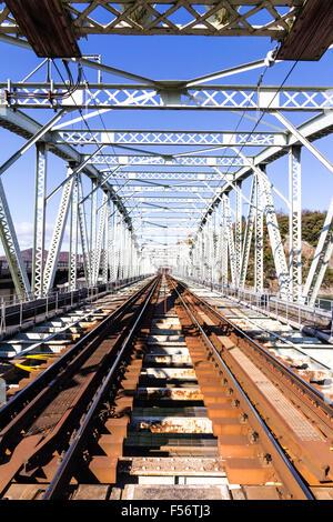 Japan, Inuyama. Kiso Line private railway. Box steel girder railway bridge, view along interior of bridge, daytime, - Stock Photo