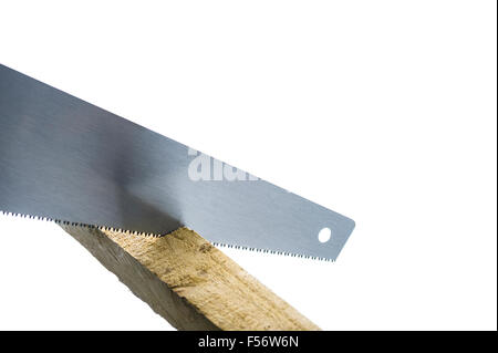 Hand saw cutting some timber. - Stock Photo