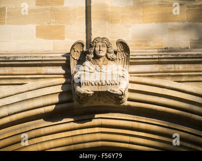 Stone carved angel above entrance to St John's College Oxford St Giles Oxford England UK