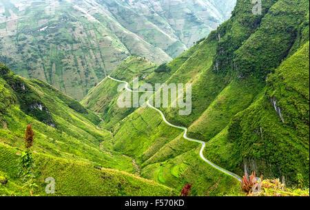 Pass road hugs the mountain plateau of Dong Van, Ha Giang, Vietnam - Stock Photo