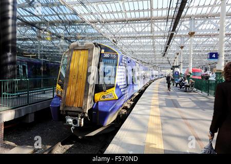 Scotrail Class 380 115 train standing at platform 4.Waverley station. Edinburgh - Stock Photo