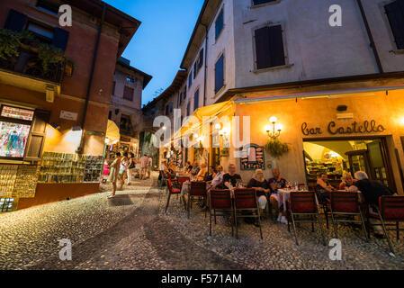 Restaurant in the evening, Malcesine, Verona province, Veneto, Italy - Stock Photo