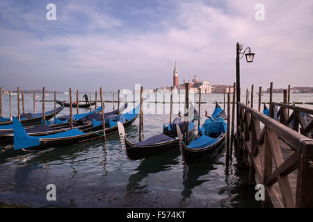 Gondolas moored near San Marco with St Giorgio Maggiore in the distance - Venice, Italy - Stock Photo