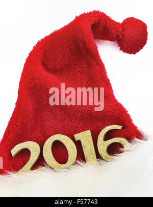 golden figures 2016 on a santa claus hat on white background - Stock Photo