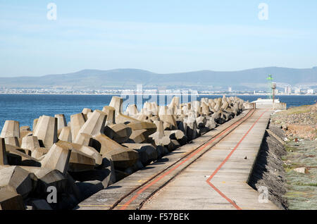 Concrete tetrapods protecting a harbour wall Cape Town South Africa - Stock Photo