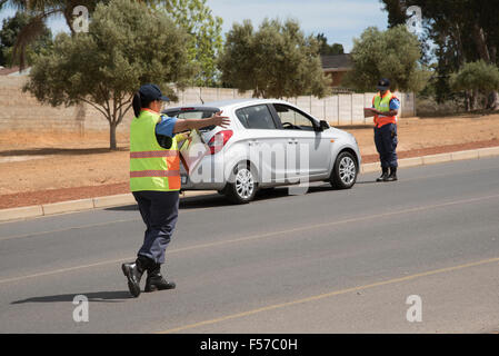 Traffic police taking driver details on roadside during a road block set up in Wellington Western Cape South Africa - Stock Photo