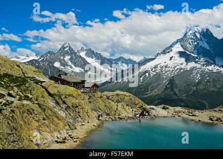 Refuge du Lac Blanc, mountain lodge, Aiguilles Rouges National Nature Reserve, Aiguille de Chardonnet behind, Chamonix - Stock Photo
