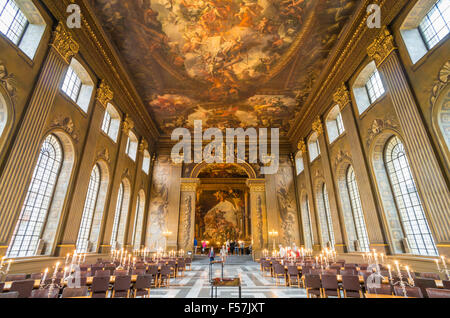 Tourists visiting The Painted Hall a dining hall in the Old Royal Naval College Greenwich London UK GB EU Europe - Stock Photo