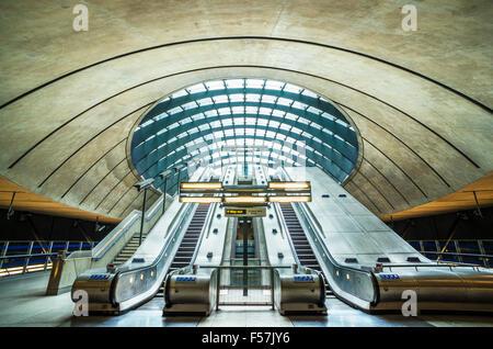 Canary wharf underground station entrance with escalators London England UK Gb EU Europe - Stock Photo