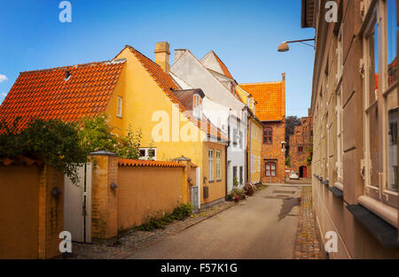 Image of a narrow residential street in the medieval town center of Helsingor, Denmark. - Stock Photo