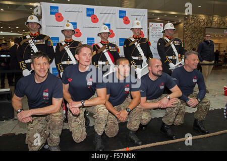 Canary Wharf, London, UK. 29th October, 2015. Military band posed with British Military Fitness instructors in Canary - Stock Photo