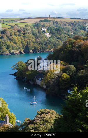 Stunning  sunny view down onto tree-lined Warfleet Creek on the River Dart with sailing boats on deep blue water - Stock Photo
