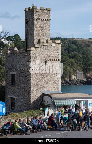 Busy tearooms at the historic Dartmouth Castle on the mouth of the River Dart in Devon with lots of people enjoying - Stock Photo