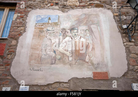 Mugnano, village of the painted walls, fresco on the wall by Giovanni Schiaroli, Umbria, Italy - Stock Photo