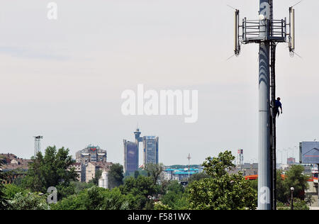 Stand for antennas and panorama of new Belgrade - Stock Photo