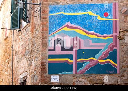 Mugnano, village of the painted walls, fresco on the wall by Massimo Arzilli, Umbria, Italy - Stock Photo