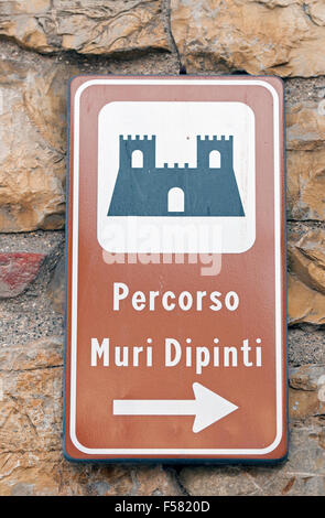 Mugnano, village of the painted walls, a sign to Painted Walls route, Umbria, Italy - Stock Photo