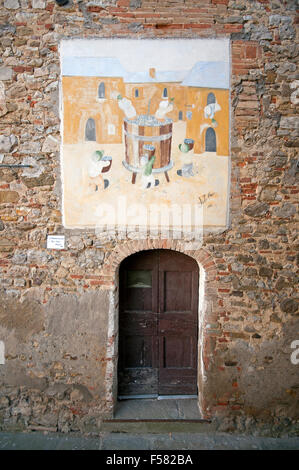 Mugnano, village of the painted walls, fresco on the wall by Mario Ortolani, Umbria, Italy - Stock Photo