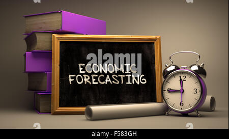 Economic Forecasting Concept Hand Drawn on Chalkboard. Blurred Background. Toned Image. - Stock Photo