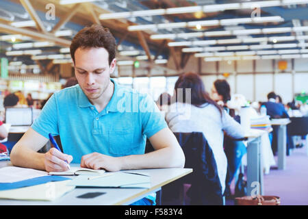 student working in modern public library of university - Stock Photo