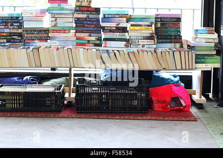 Second hand Books or novels on the tables for sale at Dandenong  market Victoria Australia - Stock Photo