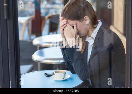 woman crying in cafe - Stock Photo