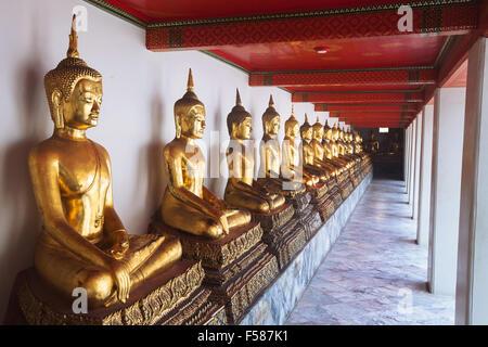 Buddha statues in Wat Pho buddhist monastery in Thailand, Bangkok - Stock Photo