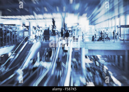 blurred people in airport terminal, blue abstract background - Stock Photo