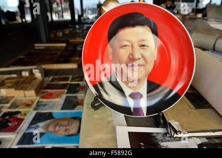 Memorabilia of Chinese president Xi Jinping is on sale in Panjiayuan flea market in Beijing, China. 2014 - Stock Photo