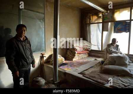 Wu Deyi, 48, who never merried because of poverty,with his father Wu Hai, 83, who suffers with brain atrophy at - Stock Photo