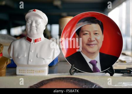 Memorabilia of Chinese president Xi Jinping is on sale with that of Mao Zedong in Panjiayuan flea market in Beijing, - Stock Photo